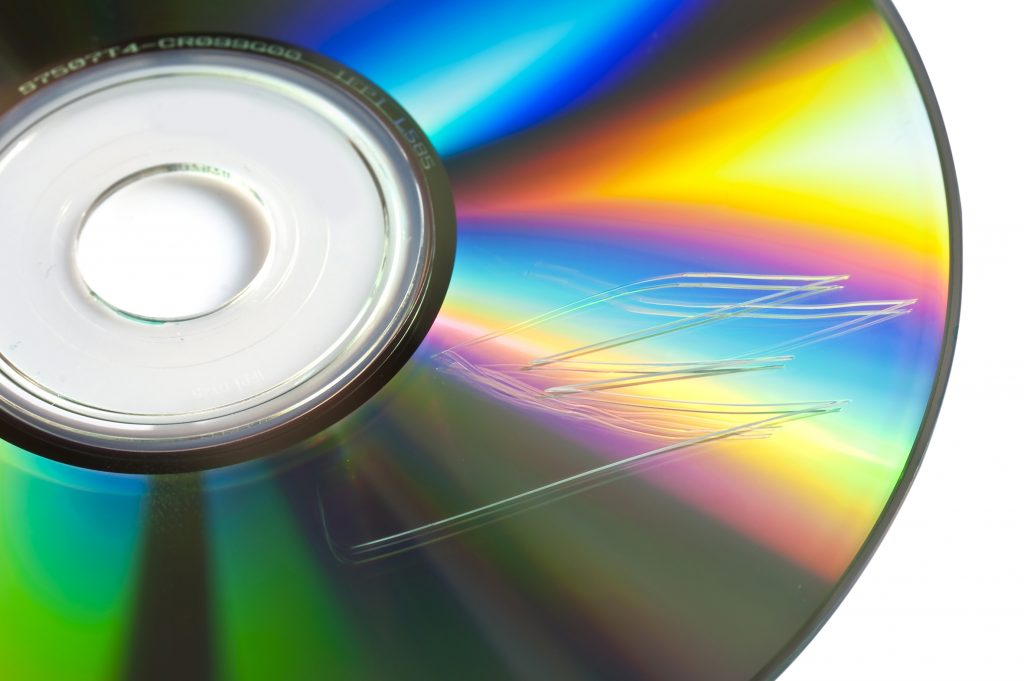 Scratched cd or dvd close up, data loss concept